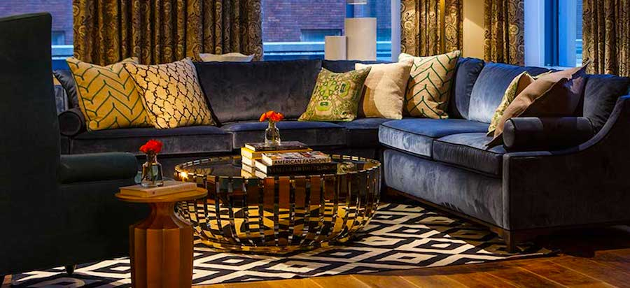 Comfortable seating in Kimpton Hotel Monaco Pittsburgh suite